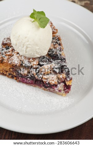 Crumble pie with black currants. English dessert with creamy ice cream - stock photo