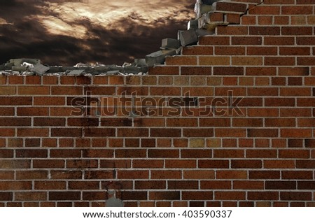 crumbling brick wall with stormy sky - stock photo