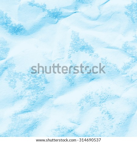 crumpled blue paper background - wet watercolor stains pattern - stock photo
