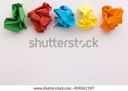 crumpled colored paper on a white background - stock photo