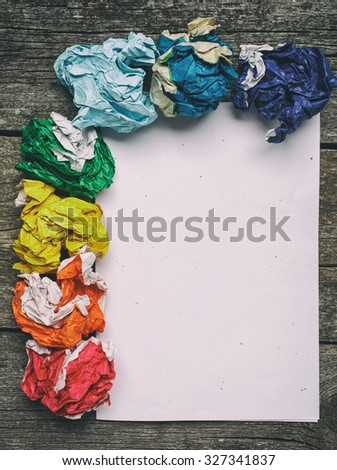 crumpled colorful paper and white paper card  on wooden background, place for tex - stock photo