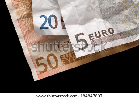 Crumpled euro money on black background - stock photo