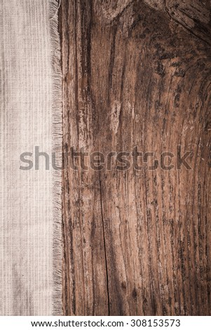Crumpled fabric on weathred wood  texture use for background - stock photo