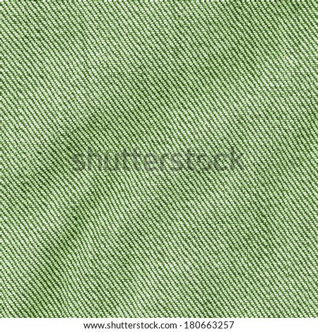 crumpled green jeans fabric closeup  - stock photo