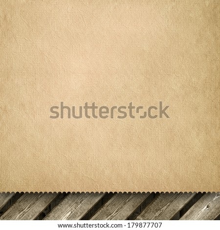 Crumpled handmade paper sheet on wooden background - stock photo