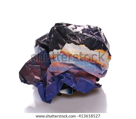 Crumpled newspaper ball isolated on white background - stock photo
