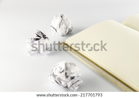 crumpled paper and notebook on a white background - stock photo