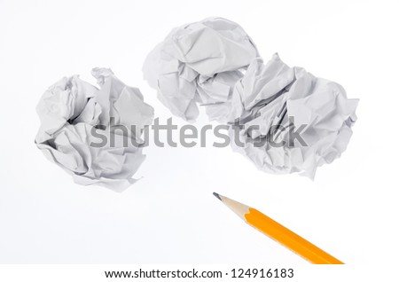 Crumpled paper ball and pencil - stock photo
