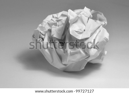 crumpled paper ball in light grey back - stock photo