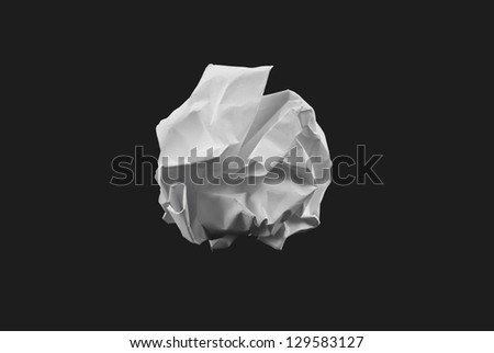 crumpled paper ball isolated on black background - stock photo