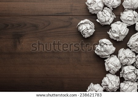 crumpled paper brainstorming in the office concept - stock photo