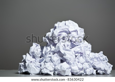 Crumpled paper on a gray background. Closeup. - stock photo