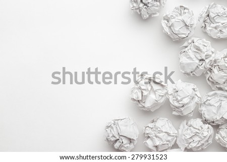 crumpled paper on white table brainstorming in the office concept - stock photo