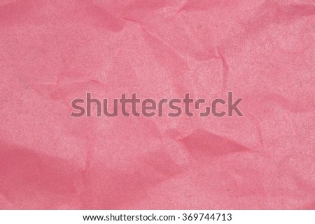 Crumpled paper texture - pink paper sheet. - stock photo