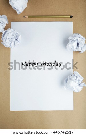 Crumpled up papers with a sheet of blank paper and a pencil on brown background - stock photo