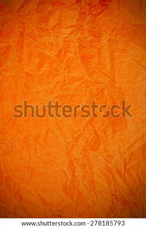 Crumpled vintage Orange paper textured obsolete background. - stock photo