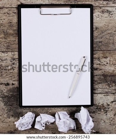 crumpled wads, blank white paper sheet in a clip folder - stock photo