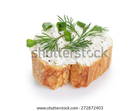 crunchy baguette slice with cream cheese and herbs isolated - stock photo