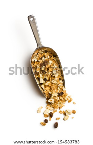 crunchy muesli in scoop on white background - stock photo