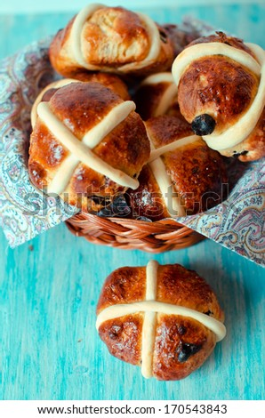 Crusades Easter buns in a wicker basket on a blue background - stock photo