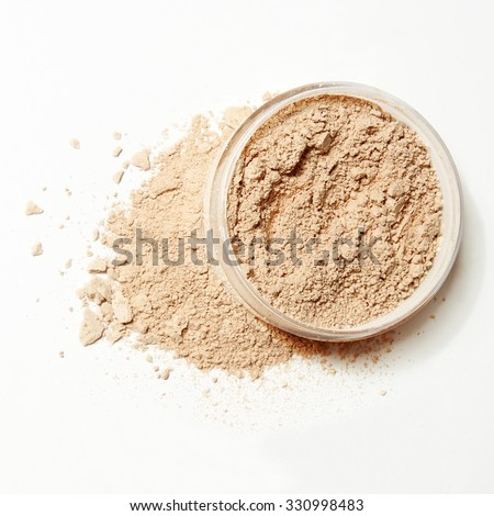 crushed crumbled natural powder make up with pack on white background - stock photo