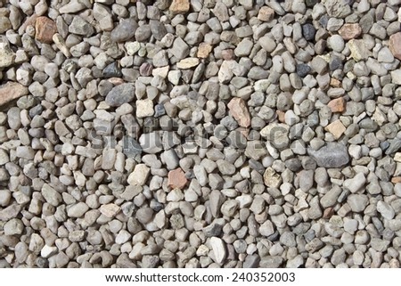 Crushed granite and pebble gravel texture, background, closeup - stock photo