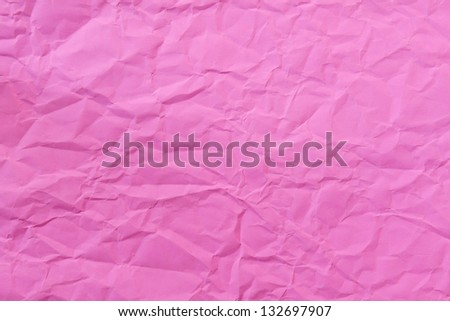 Crushed pink paper surface - stock photo