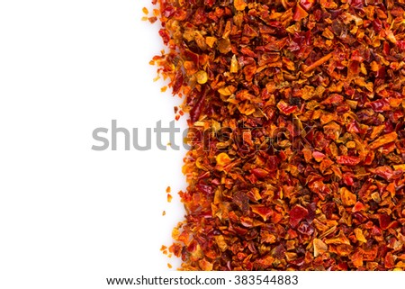 Crushed red chili pepper on white background - stock photo