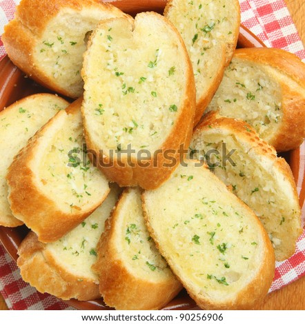 Crusty garlic and herb bread - stock photo