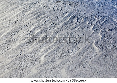 Crusty icy snow patterns - stock photo
