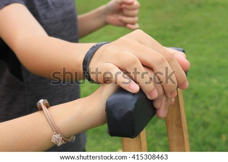 crutches made from wood and leather in the yard / Using Crutches /life on crutches/Carry On With Life While Using Crutches - stock photo