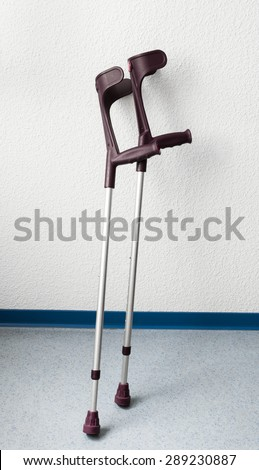 Crutches on the wall - stock photo