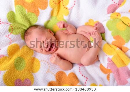 crying and screaming newborn baby - stock photo