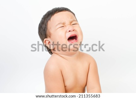 Crying Asian baby on white background  - stock photo