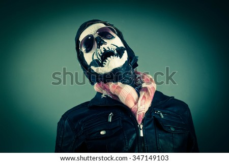 Crying aviator with face painted as human skull - stock photo