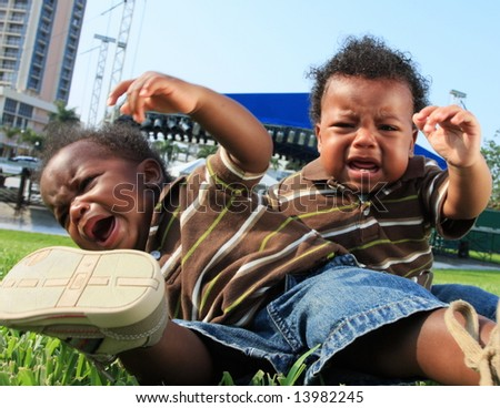 Crying Babies Toppling Over - stock photo