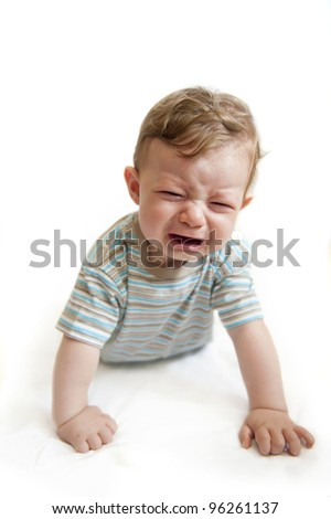 Crying baby boy on white background. - stock photo