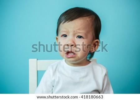 Crying baby girl , studio shot (soft focus on the eyes) - stock photo