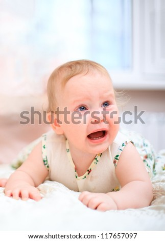 Crying baby on a light background - stock photo