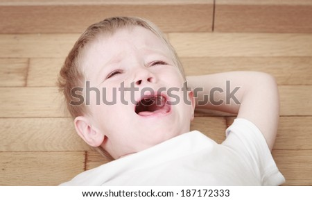 crying child in tears, stress and depression - stock photo