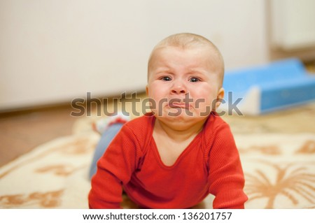crying girl laying on bed - stock photo