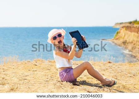 crying girl on the beach with laptop - stock photo