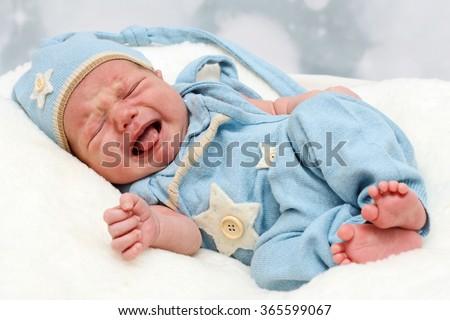 Crying little baby newborn - stock photo