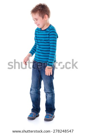 Crying little boy standing alone on white - stock photo