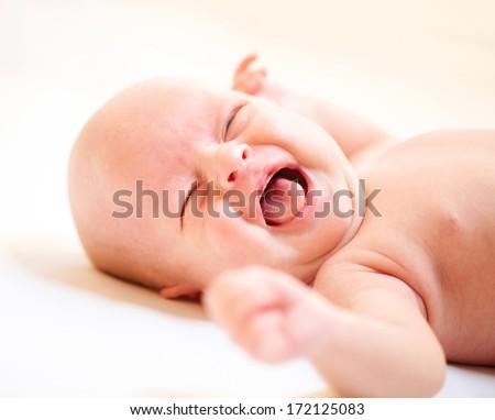 Crying Newborn Baby. Baby Boy Cry - stock photo