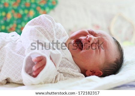 Crying Newborn Baby with narrow focus - stock photo