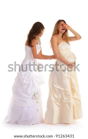 crying pregnant bride with girlfriend isolated on white - stock photo