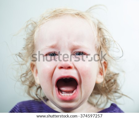 crying tears of a child blond hair - stock photo