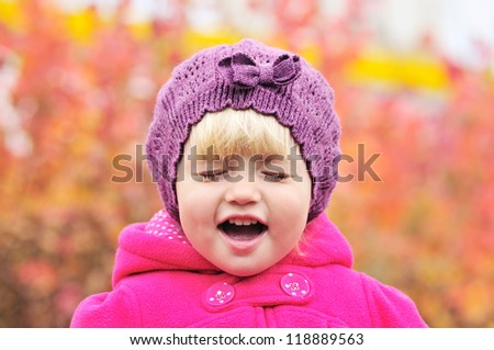 crying toddler girl on over the fall background - stock photo