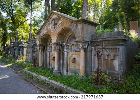 Crypt on grave in the old cemetery - stock photo